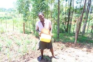 The Water Project: Elukuto Community, Isa Spring -  Watering Crops
