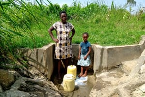 The Water Project: Musango Community, Dawi Spring -  Fetching Water