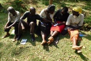 The Water Project: Wajumba Community, Wajumba Spring -  Discussing And Taking Notes