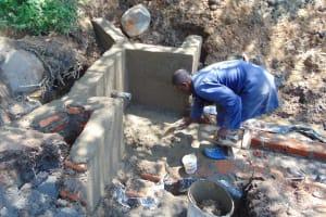 The Water Project: Eshiasuli Community, Eshiasuli Spring -  Adding Cement