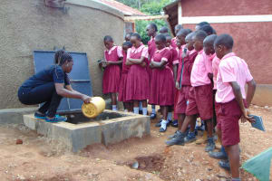The Water Project: Kitumba Primary School -  Learning About The Tank