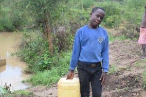 The Water Project: Mwau Community A -  Asdf_kianguni Shgir_person Carrying Water