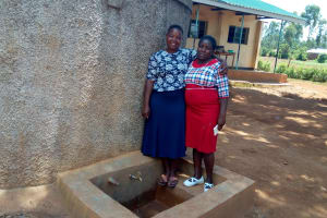 The Water Project: Munyanda Primary School -  Field Officer Betty With Sanitation Teacher Carolyne Avungana