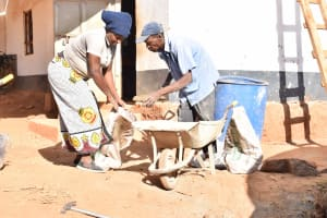 The Water Project: Kikuswi Secondary School -  Mixing Cement