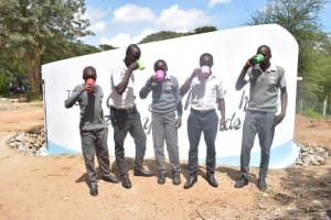 The Water Project: AIC Kyome Boys' Secondary School -  Drinking Water In Front Of The Tank