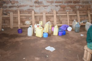 The Water Project: Kangutha Primary School -  Student Water Storage Containers Lined Up At The Back Of Class