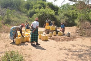 The Water Project: Nyanyaa Secondary School -  Buckets Lined Up Waiting To Be Filled At The Well