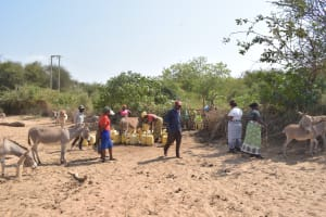 The Water Project: Nyanyaa Secondary School -  Some Of The People Waiting To Use The Water Source