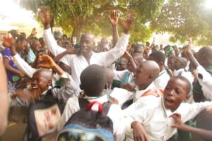The Water Project: DEC Makassa Primary School -  Head Teacher Sulaiman Ccelebrating With Students