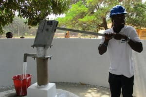 The Water Project: DEC Makassa Primary School -  Pumping Water
