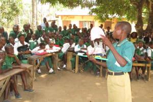 The Water Project: DEC Makassa Primary School -  Student Demonstrates Teech Brushing