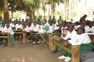 The Water Project: DEC Makassa Primary School -  Students Sit During Training