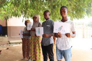 The Water Project: Mahera, SLMB Primary School -  Holding Training Materials