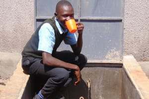 The Water Project: Hombala Secondary School -  Taking A Sip