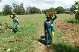 The Water Project: Mukhweya Primary School -  Students Carry Bricks And Water For Construction