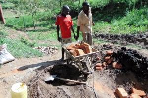 The Water Project: Emukangu Community, Okhaso Spring -  Delivering Bricks