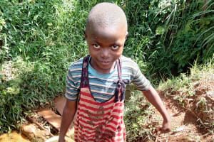 The Water Project: Emulembo Community, Gideon Spring -  Child Carrying Water
