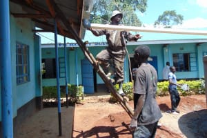 The Water Project: Hombala Secondary School -  Attaching The Gutter