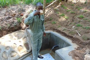 The Water Project: Emukangu Community, Okhaso Spring -  Drink Up