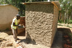 The Water Project: Eshiakhulo Primary School -  Cementing Latrine Walls