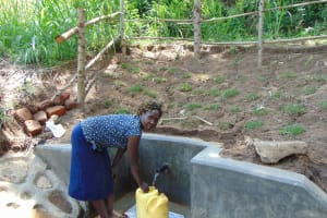 The Water Project: Emukangu Community, Okhaso Spring -  Filling Up