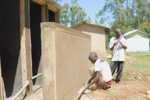 The Water Project: Eshiakhulo Primary School -  Plastering Latrine Wall