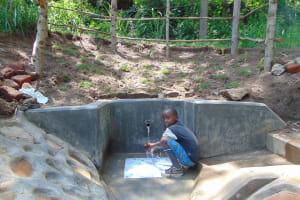 The Water Project: Emukangu Community, Okhaso Spring -  Cooling Off
