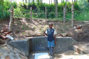 The Water Project: Emukangu Community, Okhaso Spring -  Standing Proud