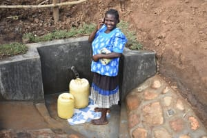 The Water Project: Ataku Community, Ngache Spring -  Chatting While Fetching Water