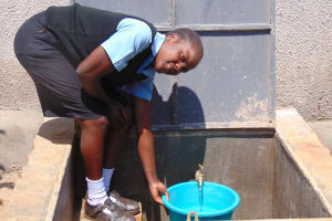 The Water Project: Hombala Secondary School -  Filling Up