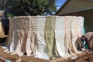 The Water Project: Kimangeti Girls' Secondary School -  Curing Cement Walls