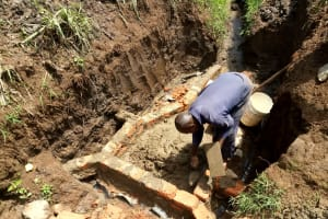 The Water Project: Ataku Community, Ngache Spring -  Bricklaying Begins