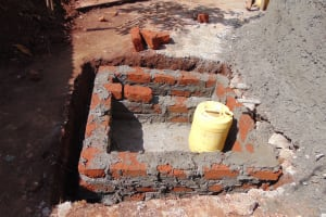 The Water Project: Hombala Secondary School -  Constructing The Tap Area