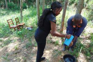 The Water Project: Emukangu Community, Okhaso Spring -  Handwashing Practice