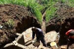 The Water Project: Ataku Community, Ngache Spring -  Construction Continues