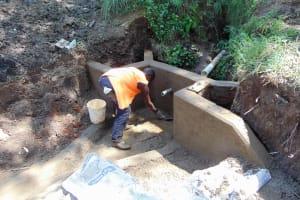 The Water Project: Emukangu Community, Okhaso Spring -  Cementing