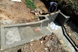 The Water Project: Ataku Community, Ngache Spring -  Backfilling The Spring Box