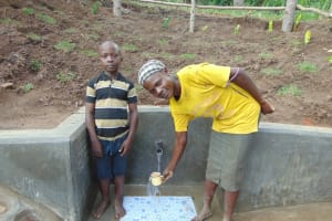 The Water Project: Emukangu Community, Okhaso Spring -  Getting A Drink