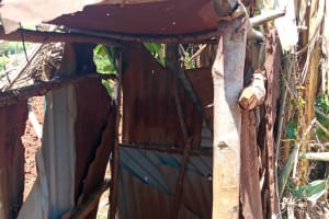 The Water Project: Emulembo Community, Gideon Spring -  Outside Latrine