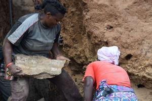 The Water Project: Kathonzweni Community -  Carrying Stone