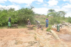 The Water Project: Mwau Community -  Hauling Stone