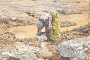 The Water Project: Mwau Community -  Lifting Rocks