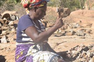 The Water Project:  Breaking Rocks