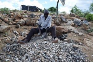 The Water Project: Kathonzweni Community A -  Breaking Up Stone