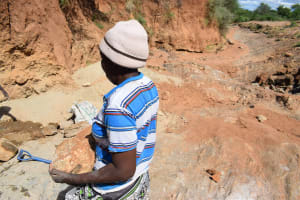 The Water Project: Kathonzweni Community A -  Carrying Rocks