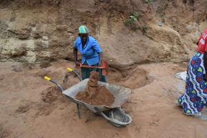 The Water Project: Kathonzweni Community A -  Hauling Dirt