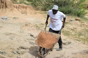 The Water Project: Mwau Community A -  Carrying Materials
