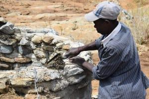 The Water Project: Mwau Community A -  Mason Working On Well