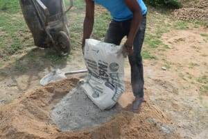 The Water Project: Mwau Community A -  Mixing Cement