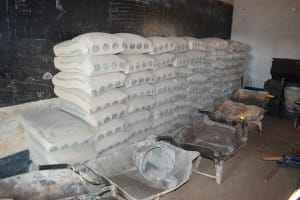 The Water Project: Kituluni Primary School -  Cement Bags Stored For Tank Construction